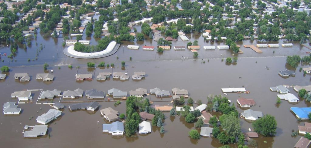 PHOTO-The Mouse (Souris) River flooding the city of Minot-2011-Courtesy of the North Dakota State Water Commission-2011-1125x534- Landscape.jpg